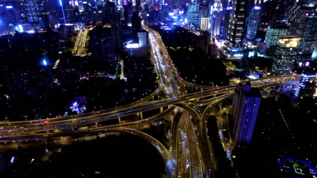 T/L Aerial View of Rush Hour Traffic on Multiple Highways and Flyovers at night/ Shanghai, China