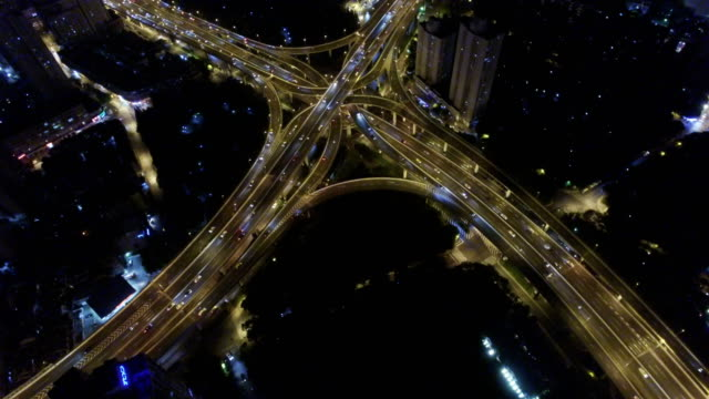 aerial view of rush hour traffic on multiple highways and flyovers at night/ shanghai, china - road junction stock videos & royalty-free footage