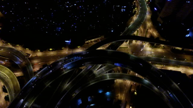 t/l aerial view of rush hour traffic on multiple highways and flyovers at night/ shanghai, china - road junction stock videos & royalty-free footage