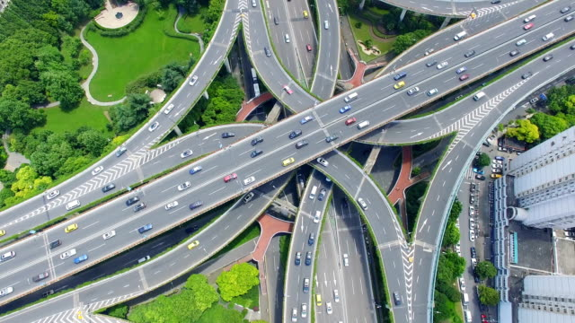 aerial view of rush hour traffic on multiple highways and flyovers/ shanghai, china - xinjiang province stock videos & royalty-free footage