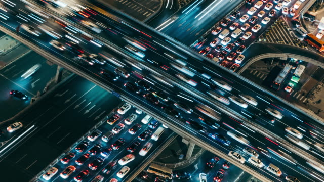 T/L MS Aerial View of Rush Hour Traffic on Multiple Highways at Night / Beijing, China