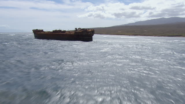 aerial view of rusty shipwreck off the coast of lanai island in hawaii. - imperfection stock videos & royalty-free footage