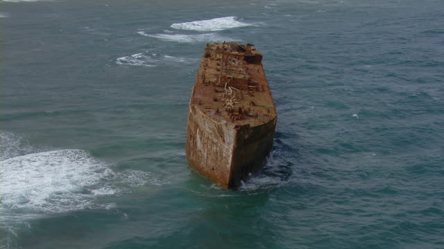 Aerial view of rusty shipwreck off the coast of Lanai Island in Hawaii.