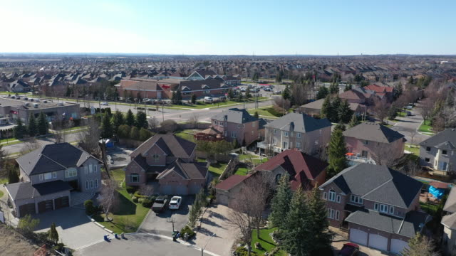 (1/3b)aerial view of rutherford road and islington ave., detached and duplex house at woodbridge in vaughan, ontario, canada - ontario canada stock videos & royalty-free footage