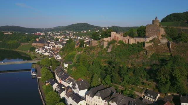 aerial view of saar river and castle ruin, saarburg, saar valley, rhineland-palatinate, germany, europe - saarburg stock-videos und b-roll-filmmaterial