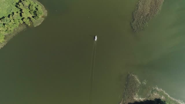 aerial view of sailboat slowly floating on lake - yacht stock videos & royalty-free footage