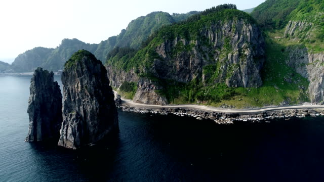 Aerial view of Samseonam rock and costal road at Ulleungdo Island (The ninth largest island in Korea)