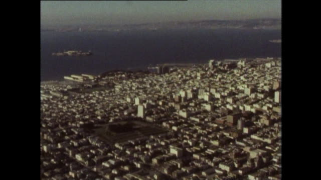 stockvideo's en b-roll-footage met aerial view of san francisco and alcatraz; 1970 - pier 39