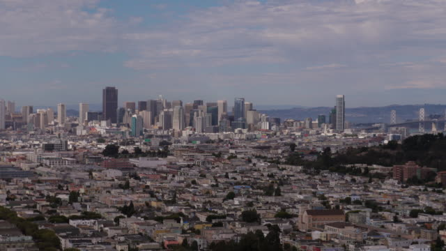 aerial view of san francisco with cloud shadows roaming over buildings. seen from the bernal heights park - spoonfilm stock-videos und b-roll-filmmaterial