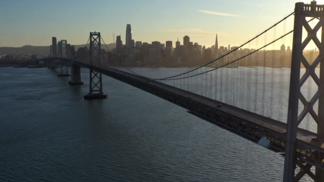 aerial view of san francisco-oakland bay bridge during covid-19 pandemic - international landmark stock videos & royalty-free footage