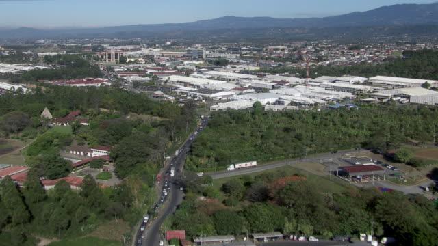 aerial view of san jose cityscape, costa rica - centro commerciale suburbano video stock e b–roll