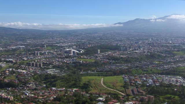 aerial view of san jose cityscape with estadio nacional de costa rica stadium, costa rica - san jose costa rica stock videos & royalty-free footage