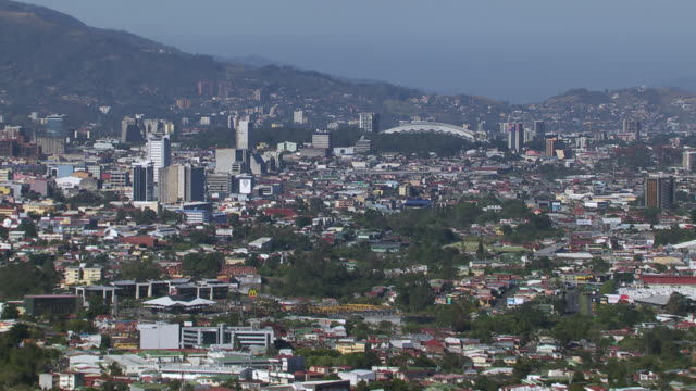 aerial view of san jose cityscape with mountain in background, costa rica - san jose costa rica stock videos & royalty-free footage