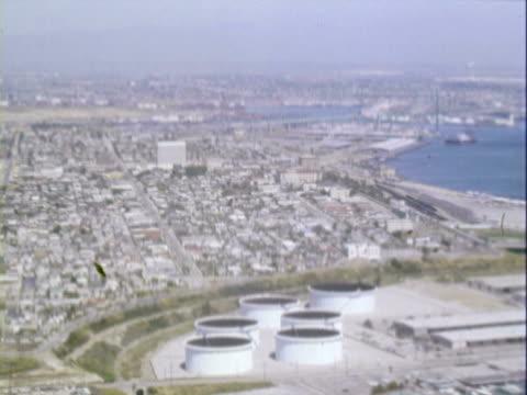 vidéos et rushes de ws aerial view of san pedro, its harbor and oil storage tanks / san pedro, california, united states - 1960