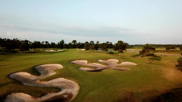 aerial view of sand traps on a golf course in beaufort, north carolina - golf stock videos & royalty-free footage