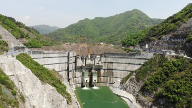 aerial view of sanhekou dam in china - dam stock videos & royalty-free footage