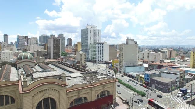 vídeos de stock, filmes e b-roll de vista aérea da cidade de são paulo-vista de mercadão - distrito financeiro