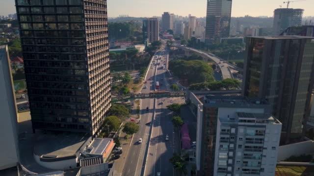 vídeos de stock e filmes b-roll de aerial view of sao paulo skyline with drone - vista geral