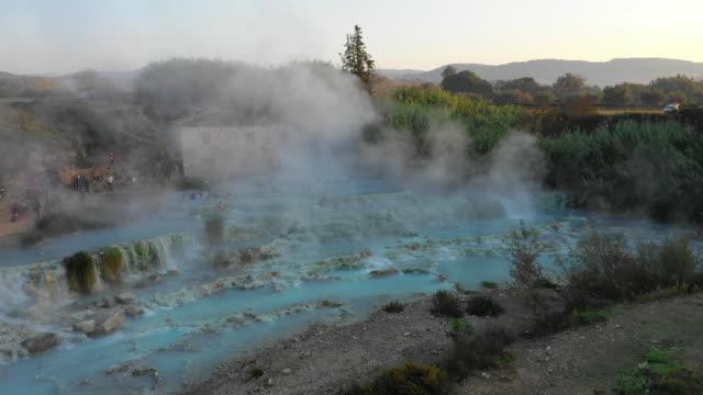 aerial view of saturnia, cascate del mulino hot spring - schwefelquellen stock-videos und b-roll-filmmaterial