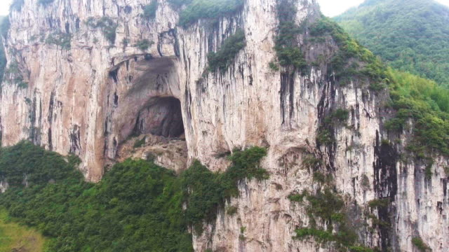 aerial view of scenic cliff of mountain and crave, guizhou province, china - cave stock videos & royalty-free footage