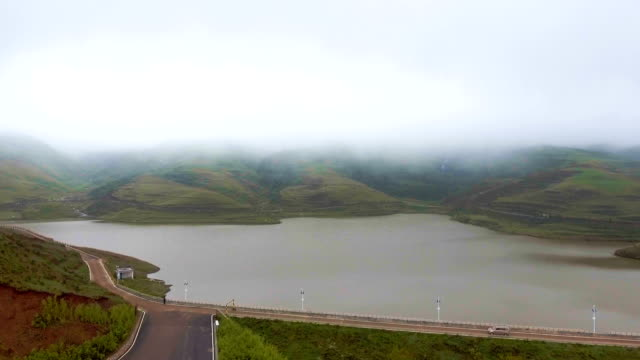 aerial view of scenic fog and lake on high mountain, china - country road stock videos & royalty-free footage
