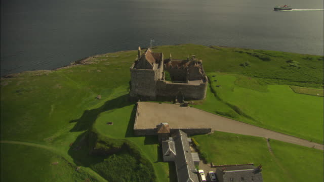 Aerial view of Scotland, to Mull, Duart Castle, Mull Home of Maclean Clan, used in film 'Entrapment', Scotland