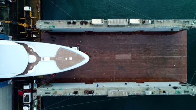 aerial view of sea dry dock, the cargo crane, boats on repair, a luxury sail yacht and motor yacht,  shipyard - yacht stock videos & royalty-free footage