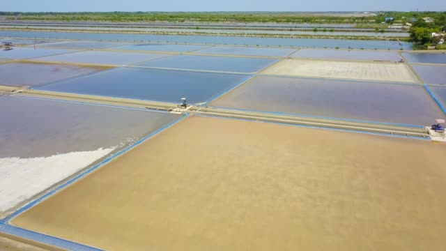 aerial view of sea salt process made from pile of salt in the salt pan by worker at rural area of thailand, samut songkhram, samut sakhorn - salt mineral stock videos and b-roll footage