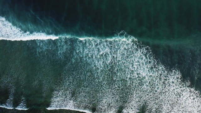 aerial view of sea surf  turquoise ocean wave in tropical island bali ,indonesia - black sand stock videos & royalty-free footage