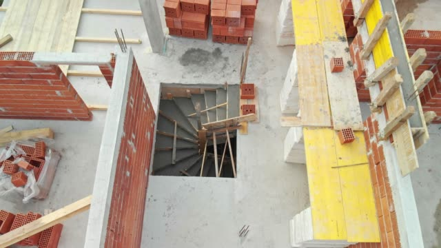aerial view of second floor construction on the new family house - brick house stock videos & royalty-free footage