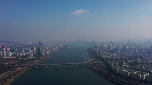 aerial view of seoul downtown city skyline with vehicle on expressway and bridge cross over han river in seoul city, south korea. - river han stock videos & royalty-free footage