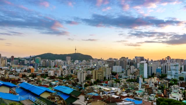 aerial view of seoul downtown cityscape and ewha wall painting village from day to night. seoul, south korea. - editorial stock videos & royalty-free footage