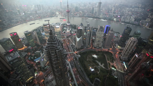 WS Aerial view of Shanghai and Huang Pu River at dusk, China