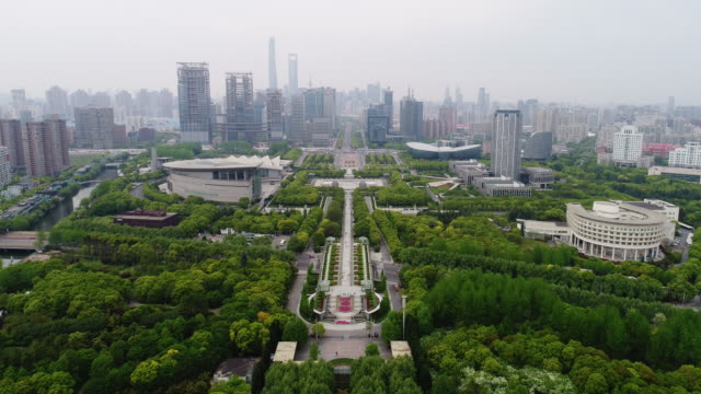 aerial view of shanghai century park and avenue in pudong - public park stock videos & royalty-free footage