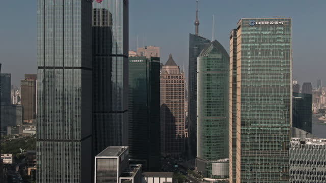 aerial view of shanghai financial district at daytime - global communications stock videos & royalty-free footage