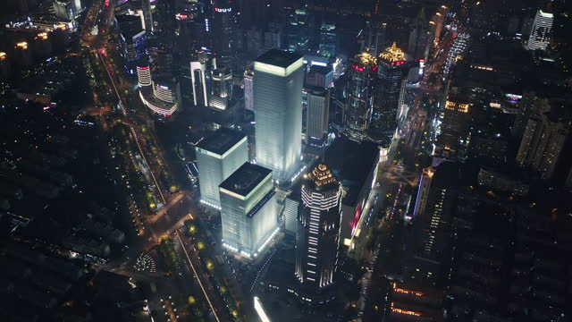 aerial view of shanghai financial district at night - 上海環球金融中心点の映像素材/bロール