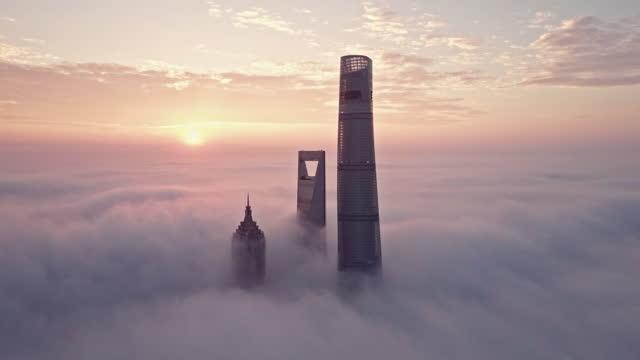 aerial view of shanghai financial district in fog - atmospheric mood stock videos & royalty-free footage