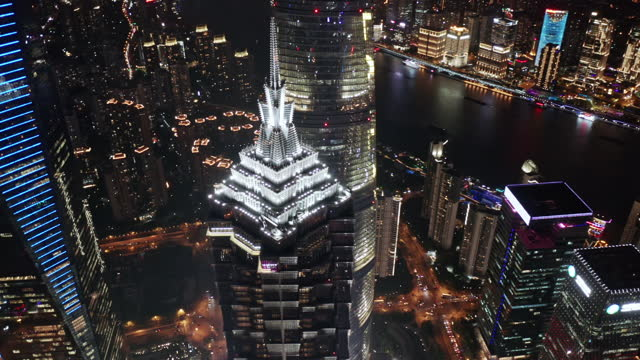 aerial view of shanghai lujiazui financial district at night - development stock videos & royalty-free footage