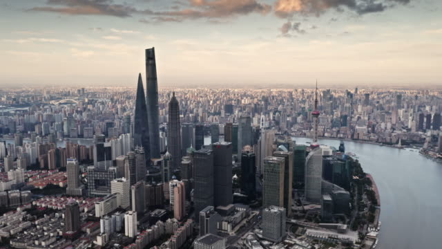 vídeos de stock, filmes e b-roll de aerial view of shanghai lujiazui financial district by drone - grande angular