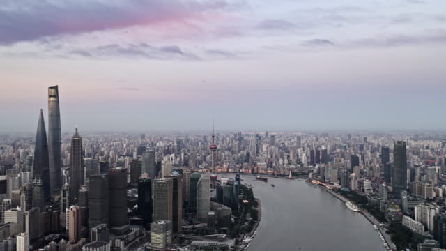 stockvideo's en b-roll-footage met aerial view of shanghai lujiazui financial district by drone - groothoek