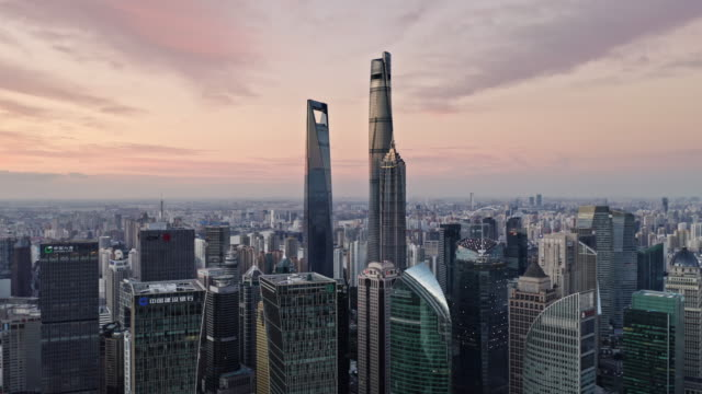 vidéos et rushes de aerial view of shanghai lujiazui financial district by drone - shanghai