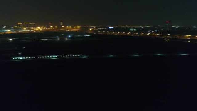 aerial view of shanghai Maglev moving fast on the rail track to the PUdong international airpport in the night