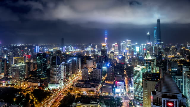 WS HA ZO Aerial View of Shanghai Skyline at Night / Shanghai, China