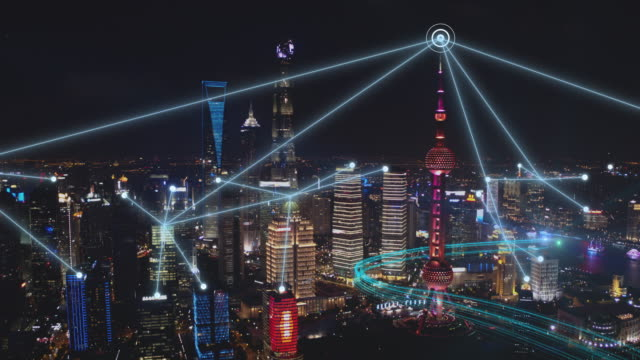 aerial view of shanghai,china.aerial city connected through 5g,smart city and communication network concept,big data digital city. - communications tower stock videos & royalty-free footage