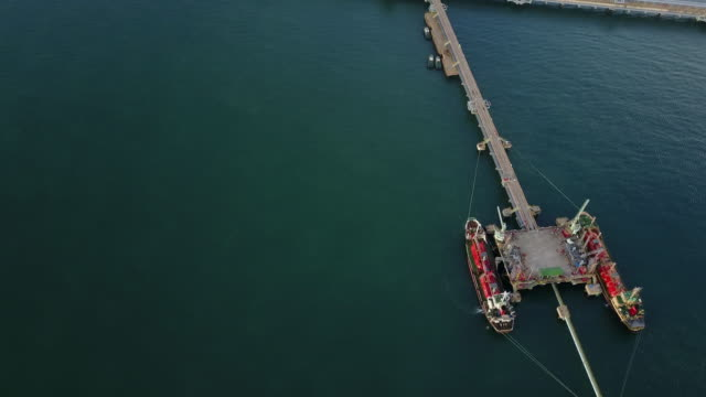 aerial view of ship dock on the ocean - refuelling stock videos & royalty-free footage