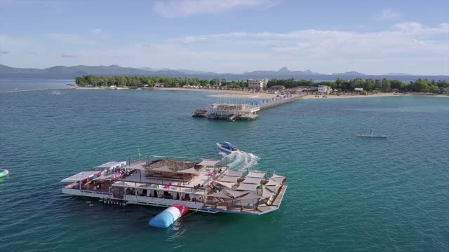 aerial view of ship in ocean against sky, drone circling over sea - lakawon, philippines - bay of water stock videos & royalty-free footage