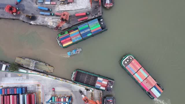 aerial view of shipping containers sitting stacked at port of huangpu on january 9, 2021 in guangzhou, guangdong province of china. - harbour stock videos & royalty-free footage