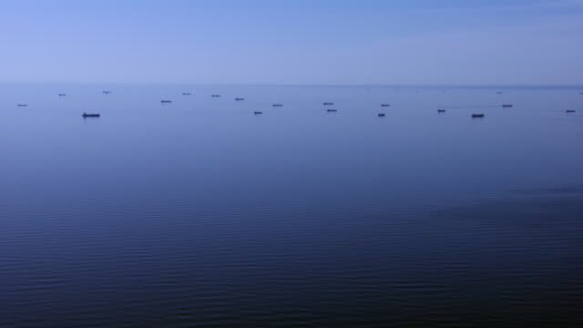 vidéos et rushes de aerial view of ships in gulf of mexico off the coast of galveston, texas. - gulf coast states