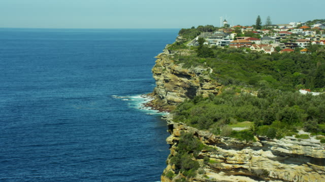 Aerial view of shoreline and Macquarie Lighthouse Sydney