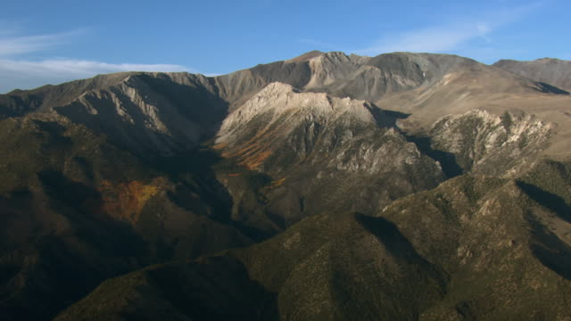 Aerial view of Sierra Nevada mountain range with forests.